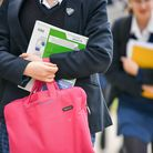 Students carry bags and books. Picture: Ben Birchall PA Archive/PA Images