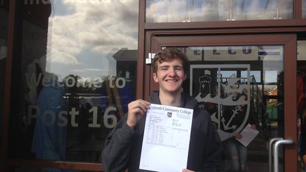Joe Mellor with his GCSE results. Picture: Daniel Wilkins