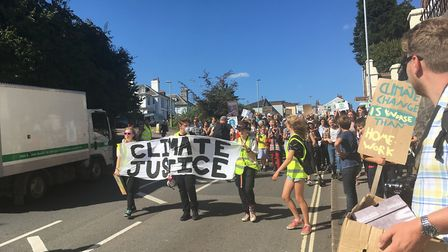 Climate change protestors march on County Hall. Picture: Daniel Wilkins