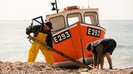 The fishing vessel Branscombe Pearl returns to the beach at Branscombe to land her catch of crab and