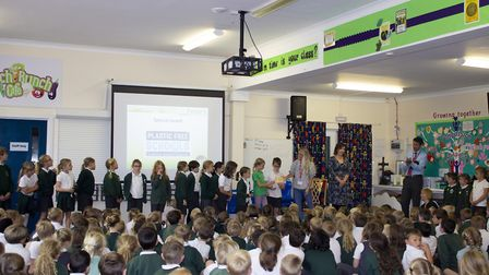 Pupils are presented with a trophy for being a plastic free school. Picture: Jemima Moore