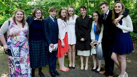 Actress Olivia Colman with sixth form students at Gresham's School speech day