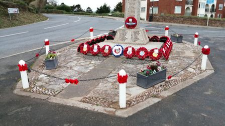Knitted poppies decorated the posts around Budleigh's war memorial. Picture: Kim Holmes