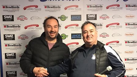 Leigh Collett receives the Town thirds Man of the Match award from team boss Shane Cox. Picture:MART