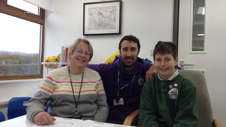 Head teacher Steve Hitchcock with volunteer Sue Stubbings and year six pupil Eliott Bright. Picture: