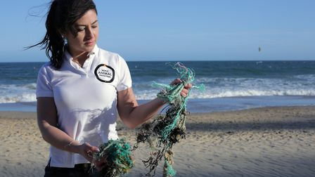 Joanna Toole holding ghost gear on a beach in the UK. Picture: World Animal Protection