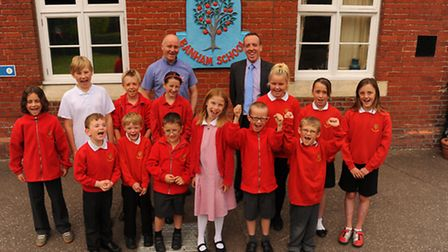 Banham Primary School pupils celebrate the school's outstanding Ofsted report with Chair of Governor