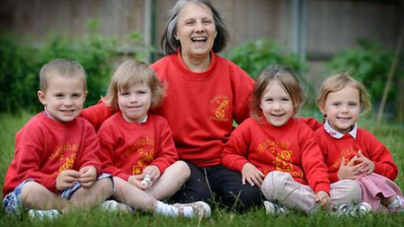 Brenda Varley is retiring from Mattishall Pre-School after 30 years, with pupils from left, Blake Wa