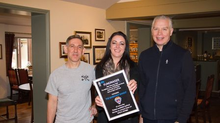 Sean Faulkner, Victoria Muckle and Graham Rooms with their fundraising poster for Prostate Cancer UK