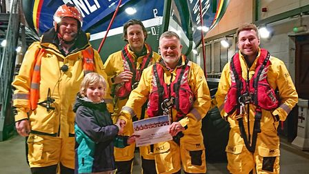 Aubrey is presented with his certificate by Deputy Coxswain, Scott Ranft. Picture: John Thorogood/Ex