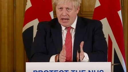 A screen-grab of Prime Minister Boris Johnson speaking at a media briefing in Downing Street, Londo