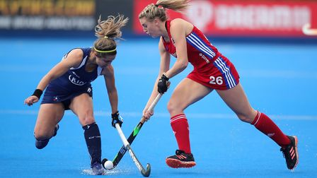 Great Britain's Lily Owsley (right) and Chile's Carolina Garcia battle for the ball during the FIH H