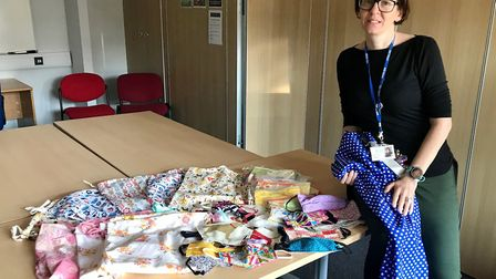 Mill Water headteacher Sarah Pickering with some of the personal protctive clothing donated. Picture