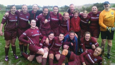 On an extremely wet April 2014, Sunday afternoon at Greenway Lane, Budleigh Salterton ladies celebra
