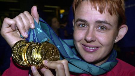 Wheelchair athlete Tanni Grey-Thompson displays her four track gold medals as she arrived at Heathro
