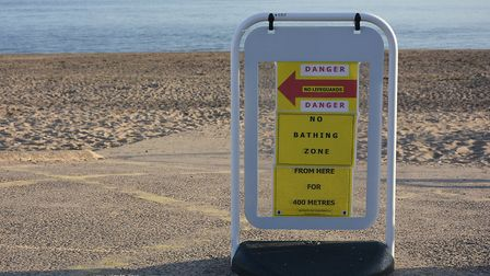 The red flag sign on display outside Coastwatch House, Queens Drive, Exmouth. Picture: Nigel Bovey