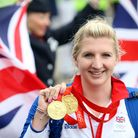 Great Britain's double Olympic gold medalist Rebecca Adlington poses as she arrives back at Heathrow