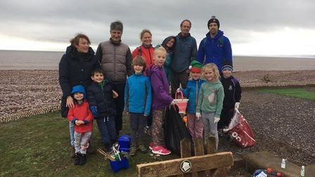 Volunteers helping in the Clean Beach Budleigh. Picture: Marta Marcota