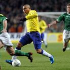 Brazil's Ronaldo takes on the Republic of Ireland's Stephen Carr during an international friendly at