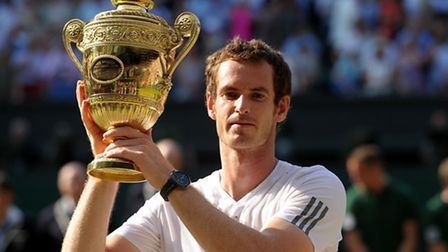 Great Britain's Andy Murray with the trophy after beating Serbia's Novak Djokovic on day 13 of the W