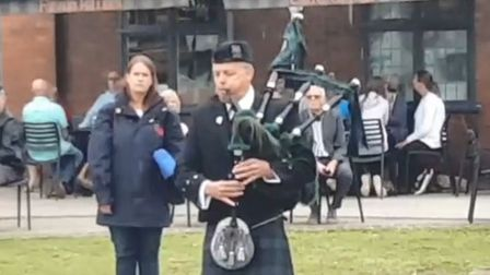 A piper played at the end of the service. Picture: Si Reed/Exmouth Royal British Legion