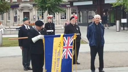 Veterans gather as the Royal British Legion Standard is lowered during the service. Picture: Si Reed