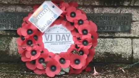 The Exmouth Royal British Legion branch laid a wreath at the step of the memorial. Picture: Si Reed/