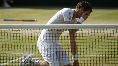 Great Britain's Andy Murray celebrates after defeating Serbia's Novak Djokovic