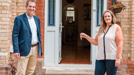 Registered manager Vicky James accepting the keys to Rolle House from Eagle One director Nick Hole.