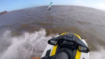 Exmouth RNLI lifeguards rescue a windsurfer. Picture: RNLI