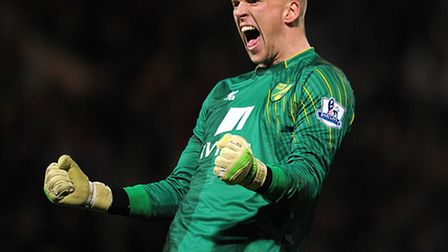 Norwich City goalkeeper John Ruddy celebrates victory after the final whistle during the Barclays Pr