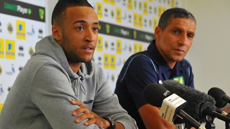 Norwich City's new signing Nathan Redmond faces the media alongside Chris Hughton at Colney on Frida