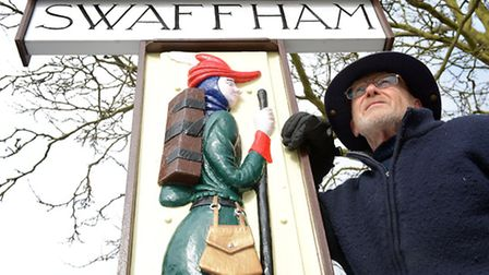 Swaffham sign has been restored and put back in the Market Place. Carpenter Colin Yorke with the sig