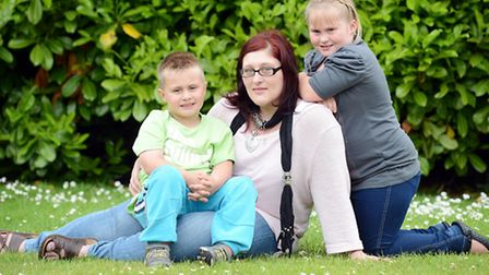 Shan Ellis with her children Ellis Hendry (5) and Cara Hendry (8). Picture: Matthew Usher.
