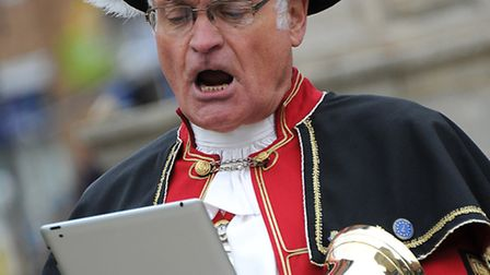 Cromer Town Crier Jason Bell reads from an iPad instead of a scroll at the digital high street openi