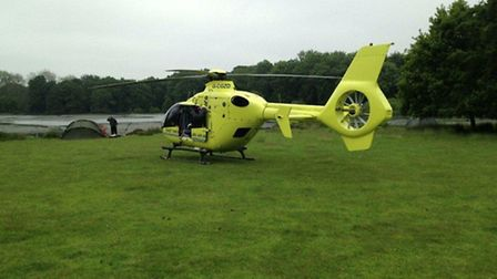 The East Anglian Air Ambulance lands near the fishing lake at Gunton Park. Picture: SUBMITTED
