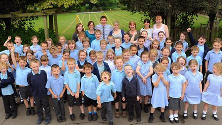 Staff and pupils at Hopton Primary School celebrate their outstanding Ofsted report. Photograph Simo