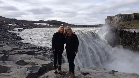 Moonwalkers Lisa Payne and Olivia Newstead relax by a waterfall in Iceland where they completed a t