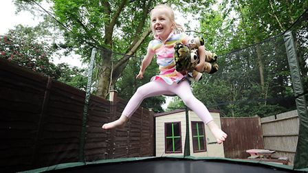 Jessica Lawrence tries out her new trampoline, with Daddy Bear. Picture: Matthew Usher.