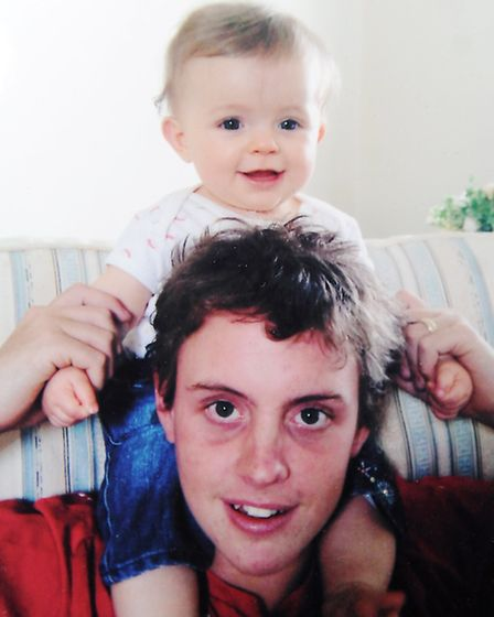 Trooper Phillip Lawrence with Jessica as a baby. Picture: Matthew Usher.