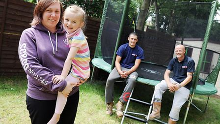 Amy with her daughter Jessica Lawrence and the trampoline in her back garden, with Nathan Halford an