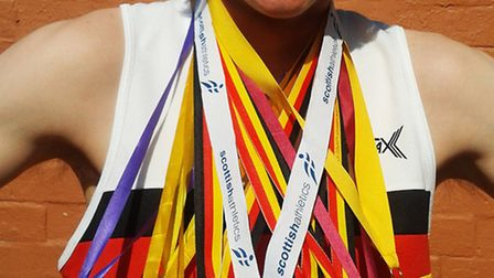 Elliot Holland with his stunning medal haul from 2012 - which has showed no sign of slowing this yea