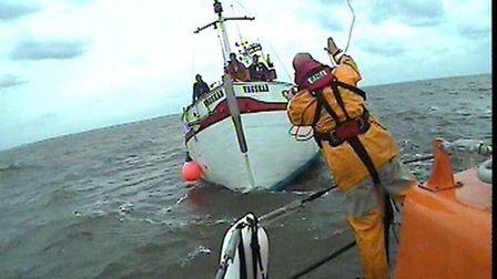 The crew of RNLI lifeboat the Spirit of Lowestoft toss a line to the stricken former fishing vessel