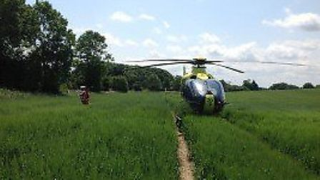 The air ambulance lands at the scene in Roughton. Picture: East of England Air Ambulance