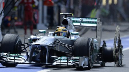 Lewis Hamilton crawls into the pits following the dramatic tyre failure that could well have cost hi