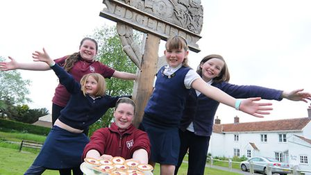 Children in Edgefield celebrating after getting planning permission to build a bus shelter in the vi