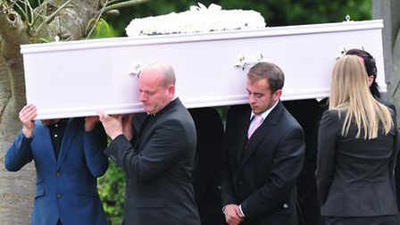 Funeral of Fiona Anderson at St Michael's church, Oulton, Lowestoft.Fiona's father Michael,carries t