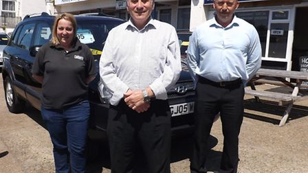 Bob Basted Car Sales is celebrating 50 years of trading in Drayton Road, Norwich. Pictured are Bob,