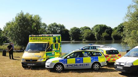 Police and paramedics at the UEA Broad last week after a body was discovered. Picture: Denise Bradle