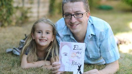 Darren Lewis is writing books inspired by his daughter Ellie's (6) love of stories. Picture: Ian Bur